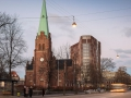 The copper coating of the façade indelibly references Copenhagen's many copper church steeples, which, together with the Maersk Tower poke up amidst the homogeneous cityscape.