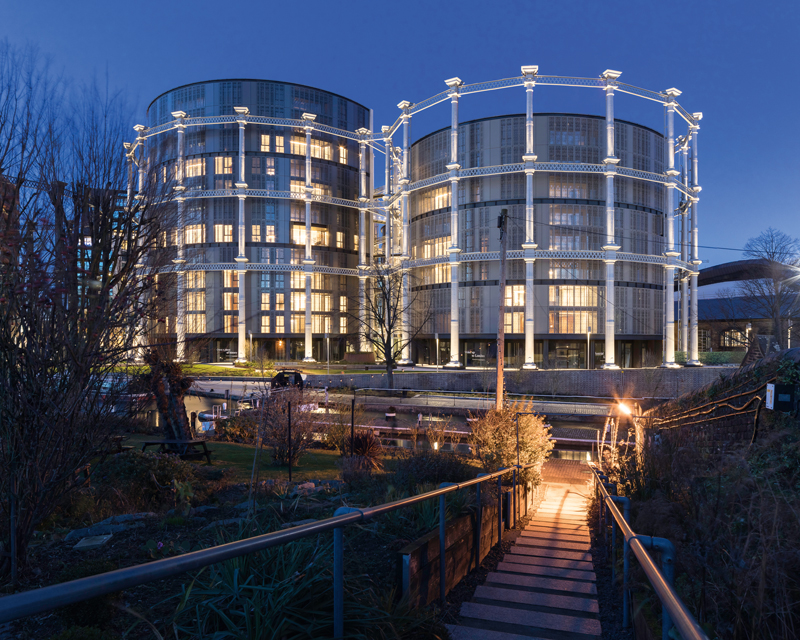 Gasholders-London-canalside-view-at-dusk-architecture-by-WilkinsonEyre,-structural-and-facade-engineer-Arup,-client-King's-Cross-Central-Limited-Partnership-@PeterLanders