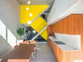 beta-three-generation-house-buiksloterham-photo-interior-kitchen-yellow-staircase-image-Ossip-van-Duivenbode