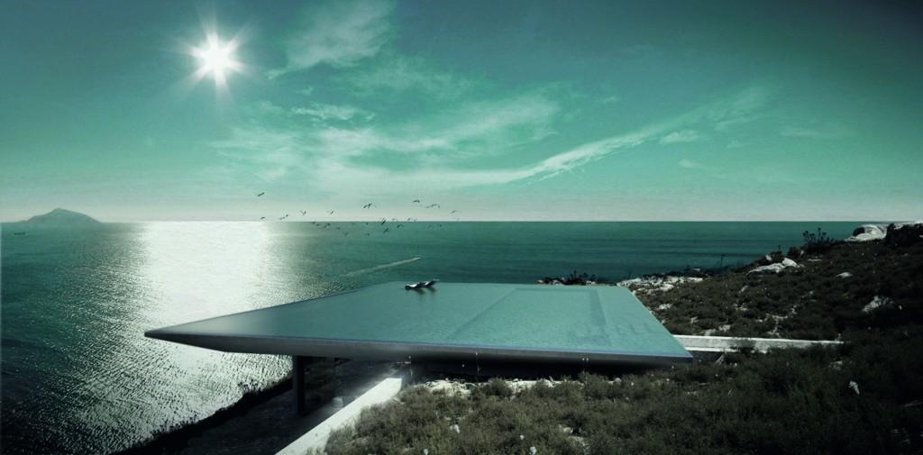 Großer Pool aus Stein, auf einer Klippe mit Blick über das Meer.